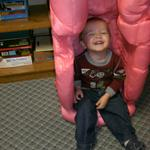 Goofing off in packing material at daddy's office